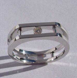 Mens / Ladies 14 Karat White Gold Ring with Round Channel Set Diamond.